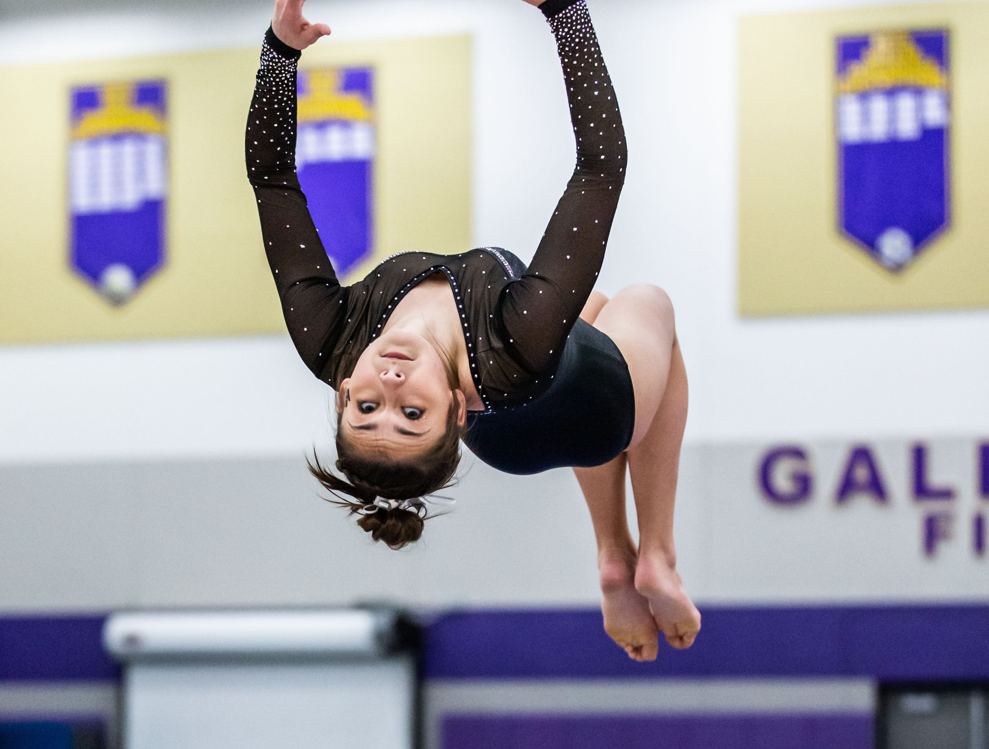 Waukesha co-op gymnast Jami Balicki dismounts off the beam during the Division 1 sectional at Oconomowoc on Friday, Feb. 22, 2019.