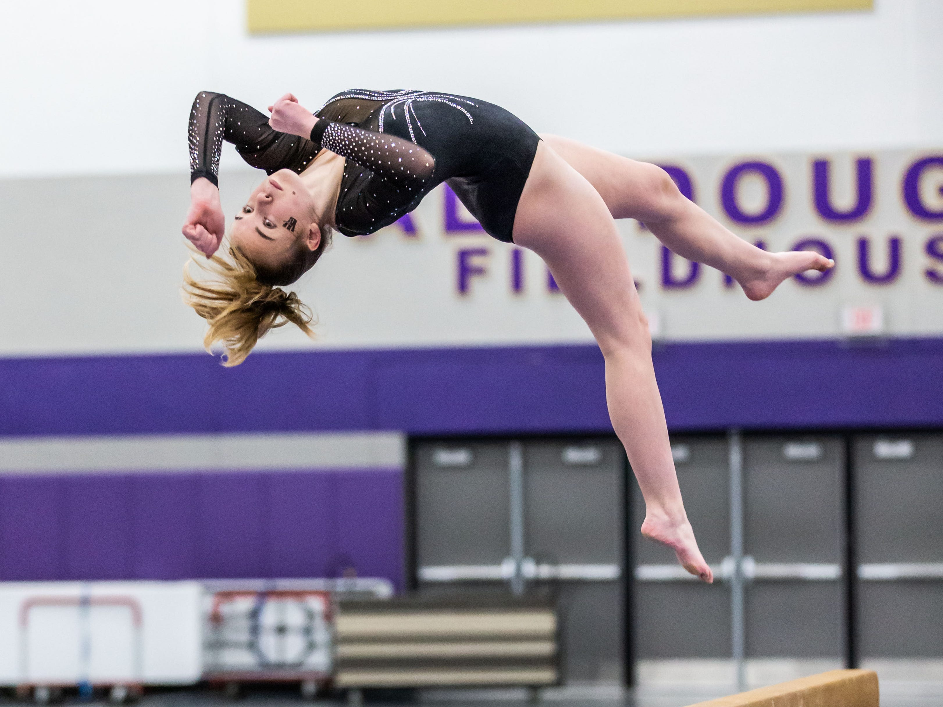 Waukesha co-op gymnast Caroline Wayer dismounts from the beam during the Division 1 sectional at Oconomowoc on Friday, Feb. 22, 2019. Wayer placed second on the beam.
