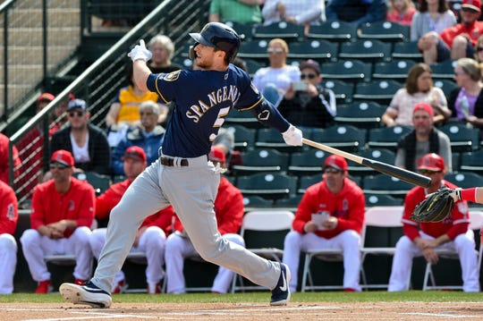 Brewers third baseman Cory Spangenberg hits a solo home run during the first inning against the Los Angeles Angels at Tempe Diablo Stadium on Monday.