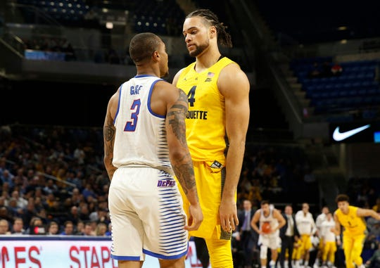 Marquette's Theo John and DePaul's Devin Gage exchange words at WinTrust Arena.