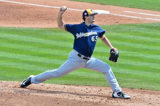 The Brewers recalled reliever Burch Smith from Class AAA San Antonio on Sunday after their bullpen was depleted during an 18-inning game the night before.