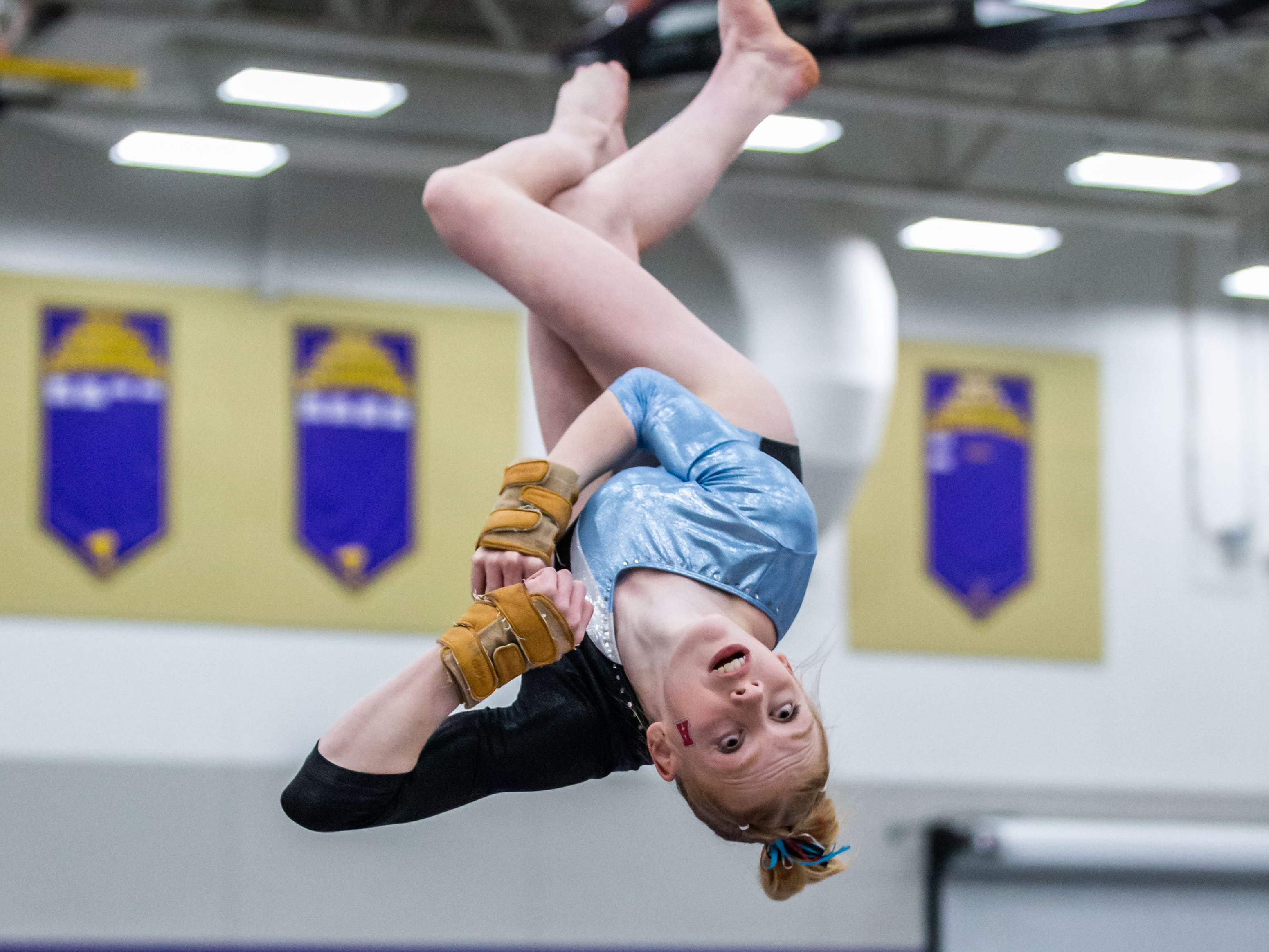Arrowhead gymnast Nina Morrison dismounts off the beam during the Division 1 sectional at Oconomowoc on Friday, Feb. 22, 2019. Morrison finished third in the all around, placing second on the floor and fourth on the bars.
