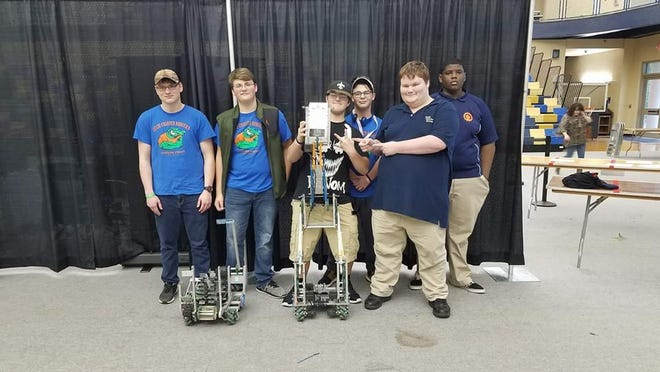 VEX Excellence winners Ethan Morris, Kyle Peters and Wyatt Wiggins pose with teammates Garrett Gray, Zachary Reddick, and Christiaan Smith after the State Championship.