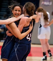 Montgomery Academy's Gabby Ramirez hugs Leighton Robertson as they defeat Winfield in AHSAA Class 3A final four action at Legacy Arena in Birmingham, Ala. on Tuesday February 26, 2019.
