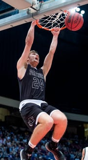Prattville Christian's Cooper Meadows dunks the ball against Plainview in AHSAA Class 3A final four action at Legacy Arena in Birmingham, Ala. on Tuesday February 26, 2019.