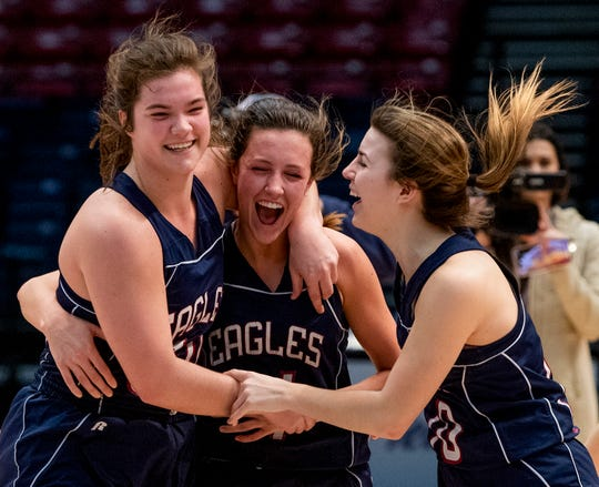 Montgomery Academy's Margaret Head, from left, Leighton Robertson and  Madi Caddell celebrates their win over Winfield in AHSAA Class 3A final four action at Legacy Arena in Birmingham, Ala. on Tuesday February 26, 2019.