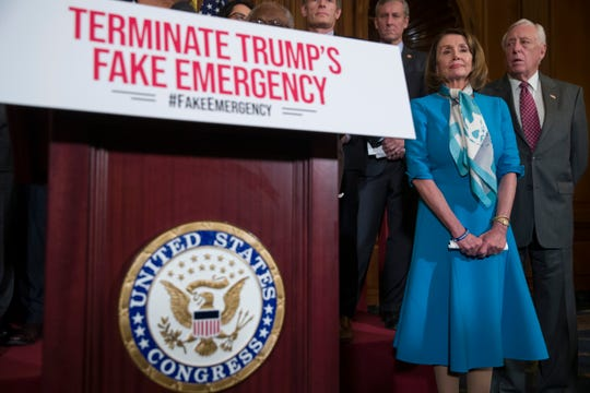 House Speaker Nancy Pelosi of Calif., left, stands with House Majority Leader Steny Hoyer of Md., and others, listens to a speaker about a resolution to block President Donald Trump's emergency border security declaration on Capitol Hill, Monday, Feb. 25, 2019, in Washington. House Democrats have introduced a resolution to block the national emergency declaration that President Donald Trump issued last week to fund his long-sought wall along the U.S-Mexico border, setting up a fight that could result in Trump's first-ever veto. (AP Photo/Alex Brandon)