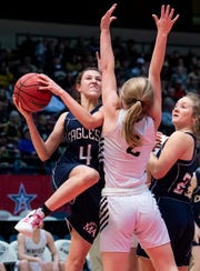 Montgomery Academy's Leighton Robertson shoots against Winfield's Abbie Junkin in AHSAA Class 3A final four action at Legacy Arena in Birmingham, Ala. on Tuesday February 26, 2019.