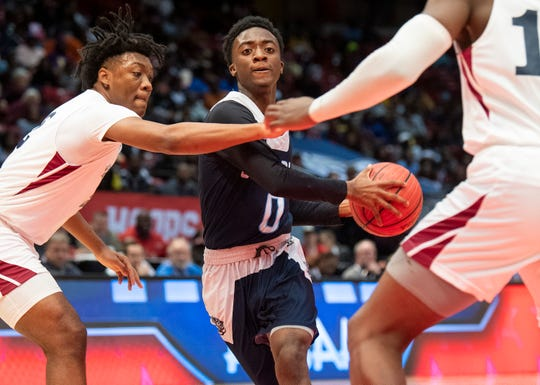 Calhoun's Dremaricus Hayes drives against Sacred Heart in AHSAA final four action at Legacy Arena in Birmingham, Ala. on Monday February 25, 2019.