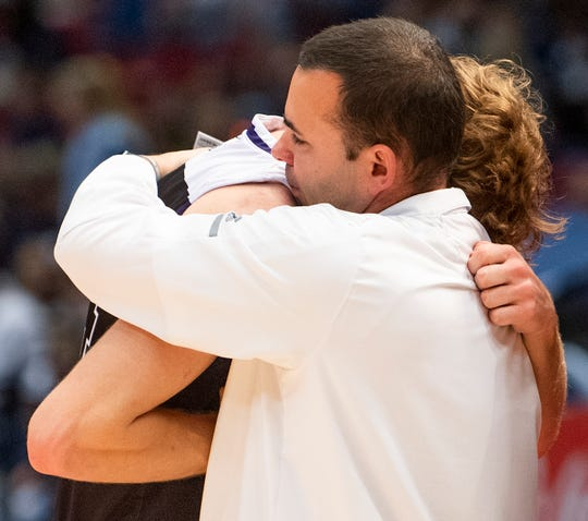 Prattville Christian's Cooper Meadows hugs coach Jason Roberson after their loss to Plainview in AHSAA Class 3A final four action at Legacy Arena in Birmingham, Ala. on Tuesday February 26, 2019.