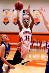 Blackman's Joelle Patton (14) goes up for a shot as Lincoln County's LeLe Stubblefield (22) guards her during the Region 4-AAA quarterfinals, on Monday, Feb. 25, 2019.