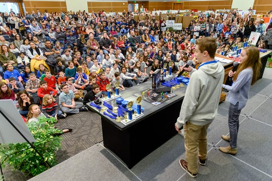 """New Jersey sibling inventor-entrepreneurs Joey, center left, and Heidi Hudicka encourage local student attending MTSU's 27th annual Invention Convention, held Feb. 21 in the university's Student Union Ballroom, to """"make that leap"""" to share their ideas with the world."""