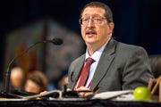 The Rev. Gary Graves, secretary of the General Conference, moderates a discussion during the 2019 Special Session of the General Conference of The United Methodist Church in St. Louis, Mo., Tuesday, Feb. 26, 2019. America's second-largest Protestant denomination faces a likely fracture as delegates at the crucial meeting move to strengthen bans on same-sex marriage and ordination of LGBT clergy. (AP Photo/Sid Hastings)