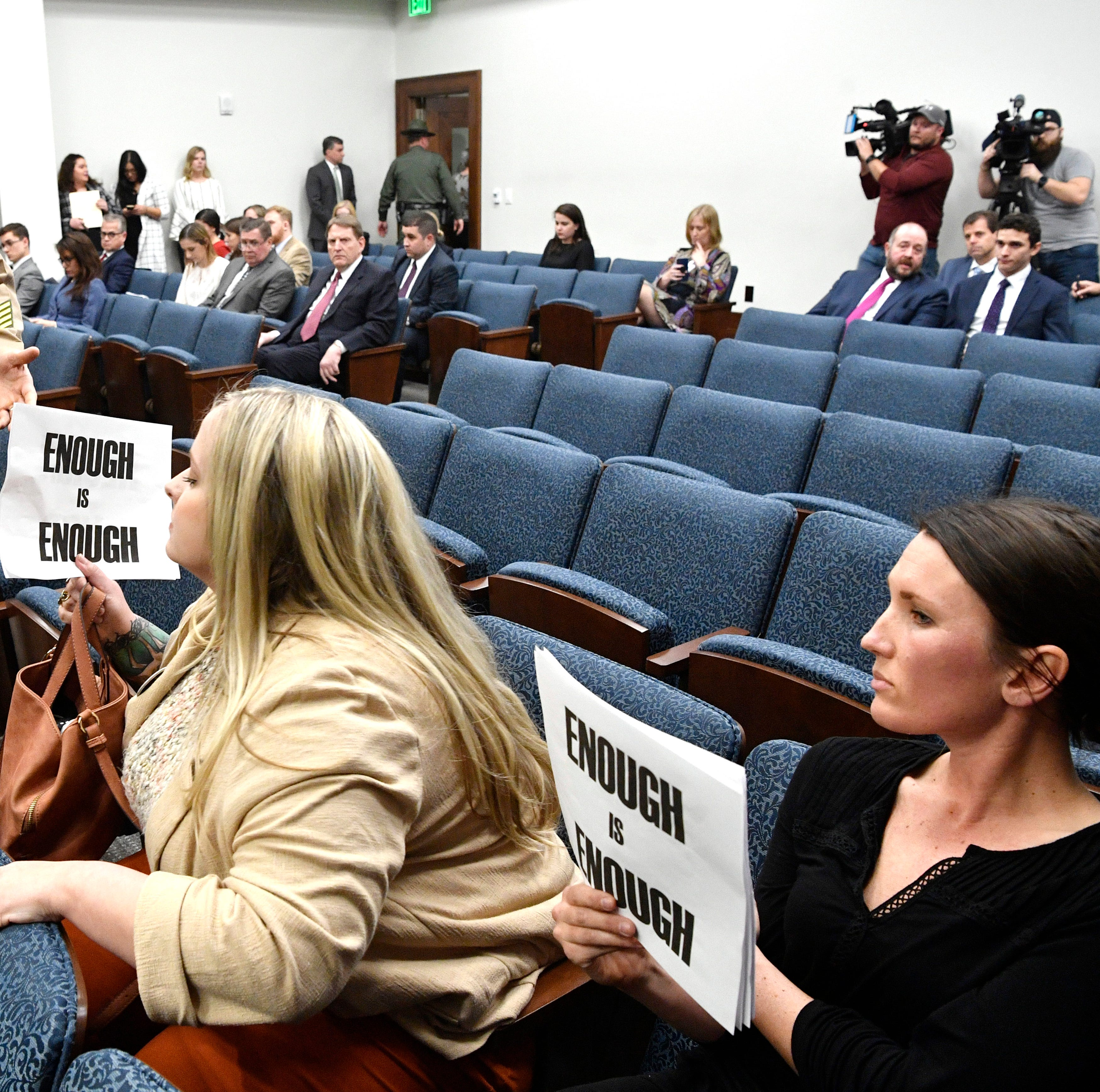 A state Trooper escorts protestors out of the House Education Administration subcommittee for holding signs where Representative David Byrd is the Chairman. They are upset with Byrd over sexual misconduct allegations Tuesday, Feb. 26, 2019, in Nashville, Tenn.