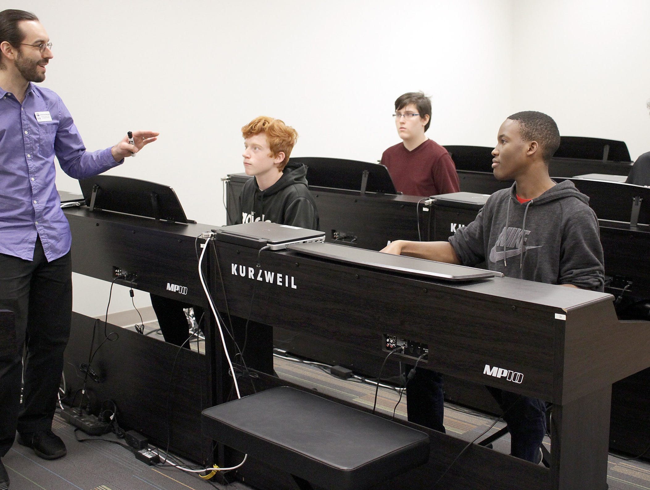 Dr. Nicholas Reynolds (Instructor of Music, Piano) teaches keyboard students at High School Music Day at Volunteer State Community College on Saturday, February 23, 2019.