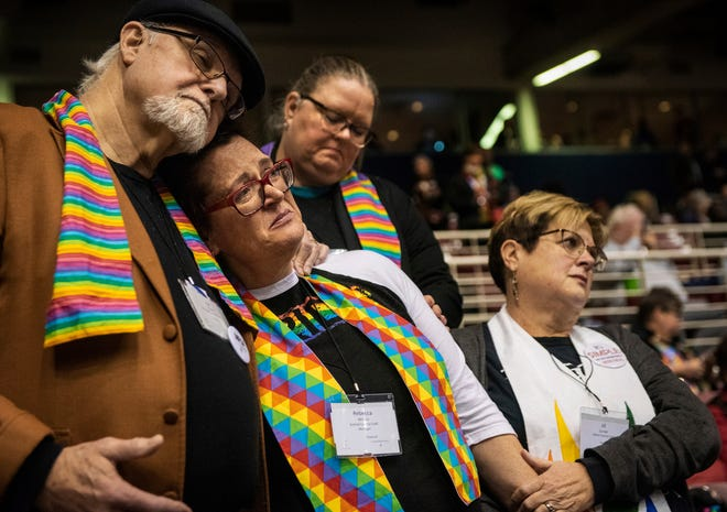 Ed Rowe (left), Rebecca Wilson, Robin Hager and Jill Zundel react to the defeat of a proposal that would have allowed LGBT clergy and same-sex marriage within the United Methodist Church. The proposal was defeated at the denomination's 2019 Special Session of the General Conference in St. Louis on Feb. 26, 2019.
