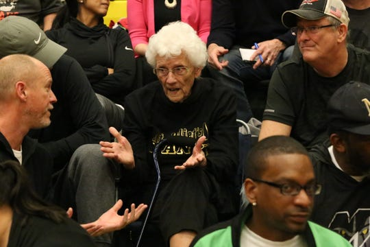 Mt. Juliet superfan Kathryn McCrary (center), who is 95 years old, rarely misses a basketball game for the program. She even travels to road games. On Monday, she was at Gallatin High School for the girls Region 5-AAA tournament semifinal.
