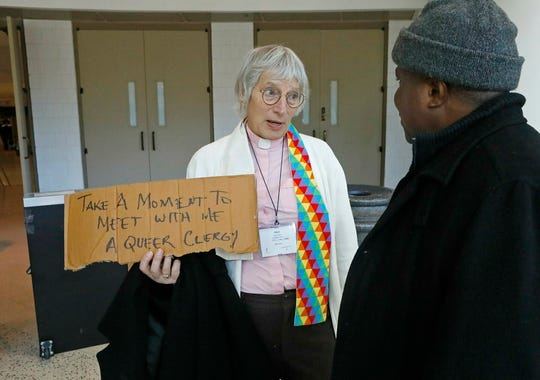 Alyss Swanson, a transgender United Methodist deacon from San Jose, Calif., speaks with Bishop Samuel Quire, from Liberia, during the General Conference of the United Methodist Church on Monday, Feb. 25, 2019, in St. Louis. Bishop Quire said people can not speak freely about their sexual orientation in Liberia, unlike the way people talk openly in the United States. (J.B. Forbes/St. Louis Post-Dispatch via AP)