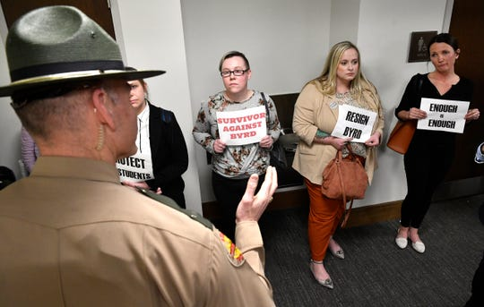 After removing them, a state trooper explains that these protesters couldn't hold signs in the House Education Administration subcommittee where Rep. David Byrd is the chairman.  They are upset with Byrd over sexual misconduct allegations Tuesday, Feb. 26, 2019, in Nashville, Tenn.
