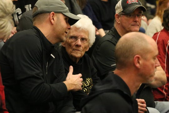 Mt. Juliet superfan Kathryn McCrary (center) talks with family members before the start of a girls Region 5-AAA semifinal basketball game against Beech on Monday at Gallatin High School.