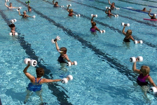 Instructor Corrie Marvin leads a water aerobics class at the Maryland Farms YMCA in 2002.
