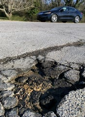 A pothole on Collins Road in Bellevue on Tuesday, Feb. 26, 2019.