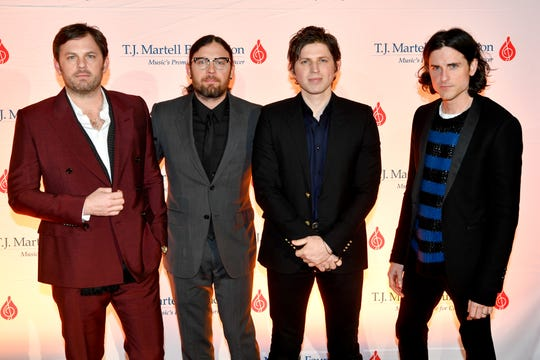 Kings of Leon pose on the red carpet at the TJ Martell 11th annual Nashville Honors Gala Monday, Feb. 25, 2019, in Nashville, Tenn.