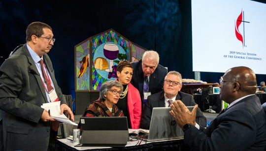 Leaders from the United Methodist Church, including Louisiana Bishop Cynthia Fierro Harvey, (center), confer during the 2019 Special Session of the General Conference of The United Methodist Church in St. Louis, Mo., Tuesday, Feb. 26, 2019.
