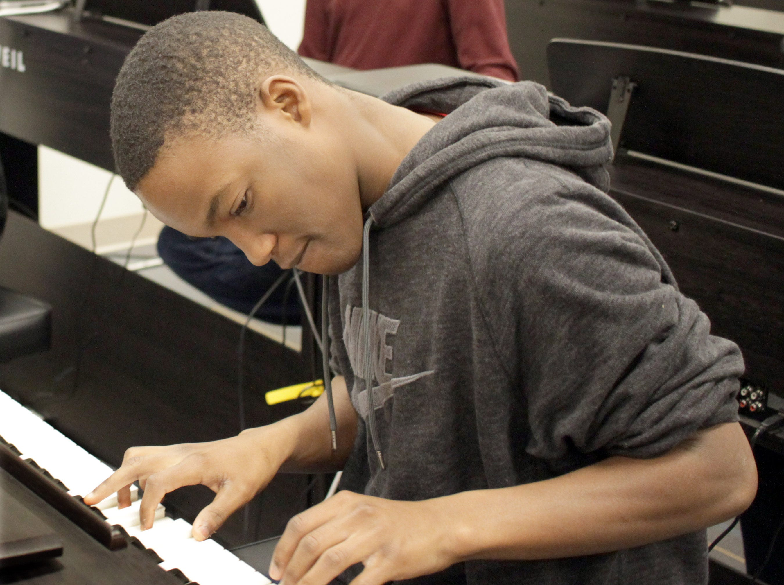 Xzaivier Robinson plays the keys in a keyboard class as part of High School Music day at Volunteer State Community College on Saturday, February 23, 2019.