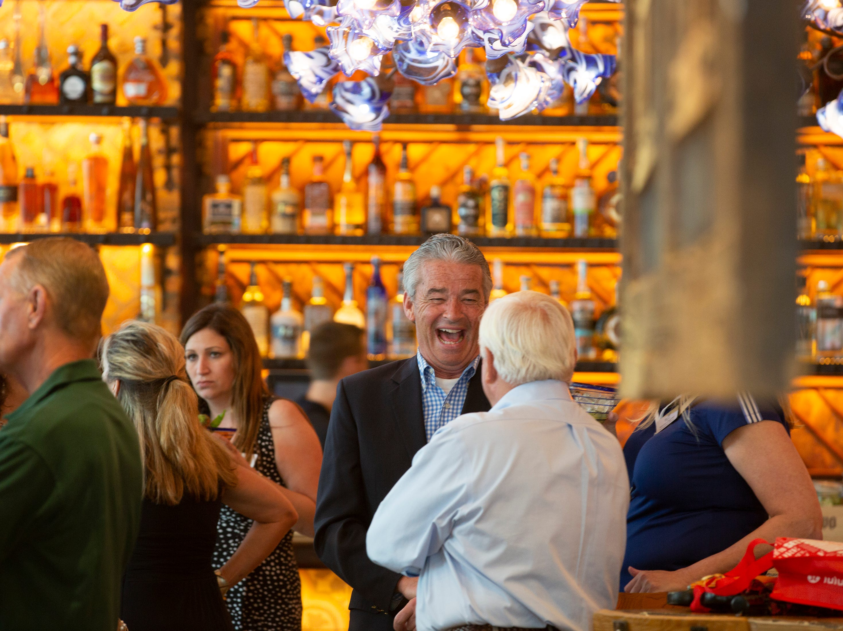 Invited guests enjoy drinks during a soft opening, Tuesday, Feb. 26, 2019, at Rocco's Tacos & Tequila Bar in Naples.