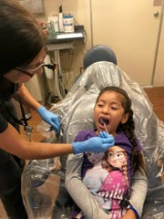Young patient receiving a dental screening on the Ronald McDonald Care Mobile.