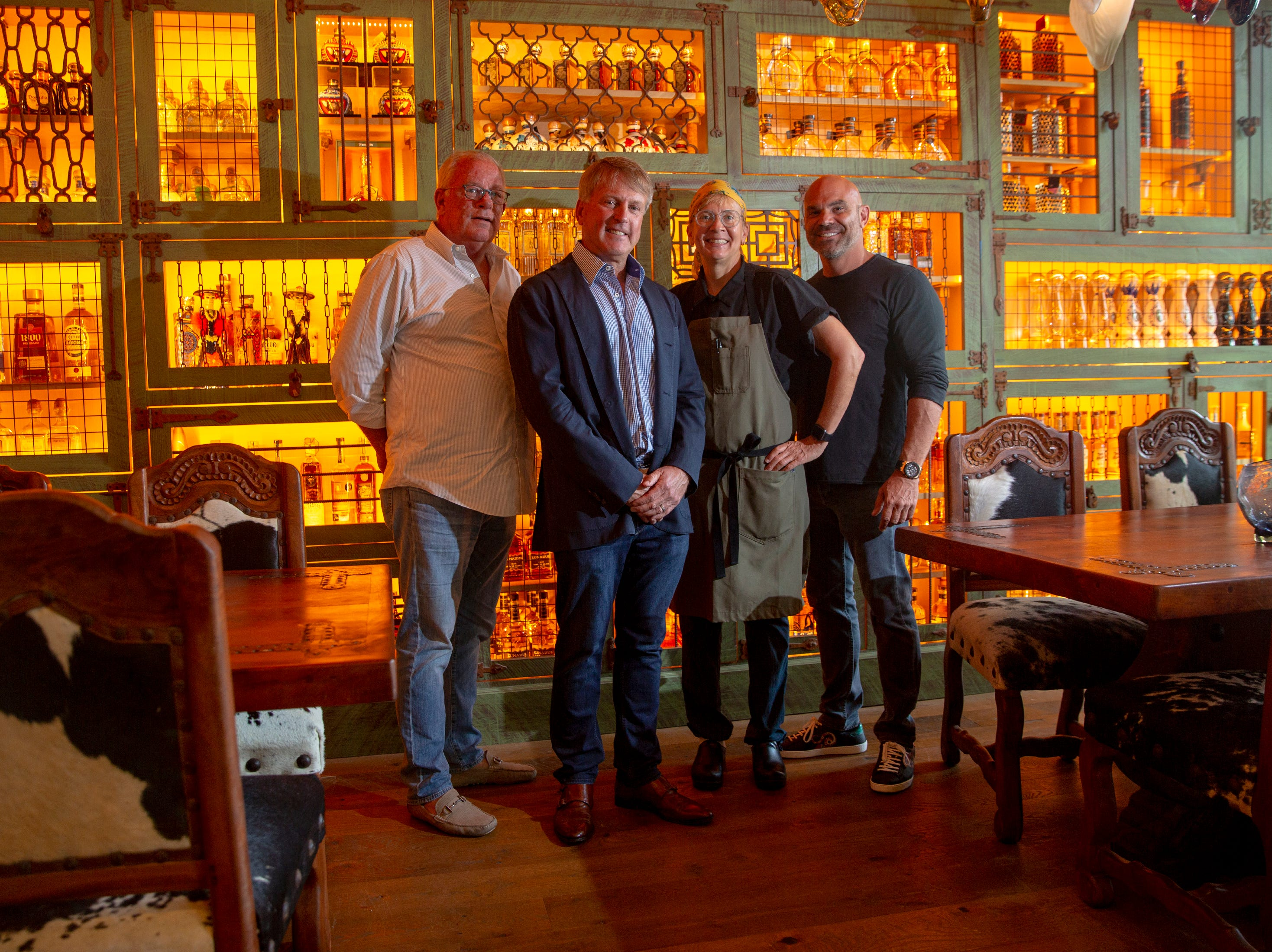 Bill Watson, Todd Herbst, Lisabet Summa and Rocco Mangel pose for a portrait at Rocco's Tacos & Tequila Bar, Tuesday, Feb. 26, 2019, in Naples.