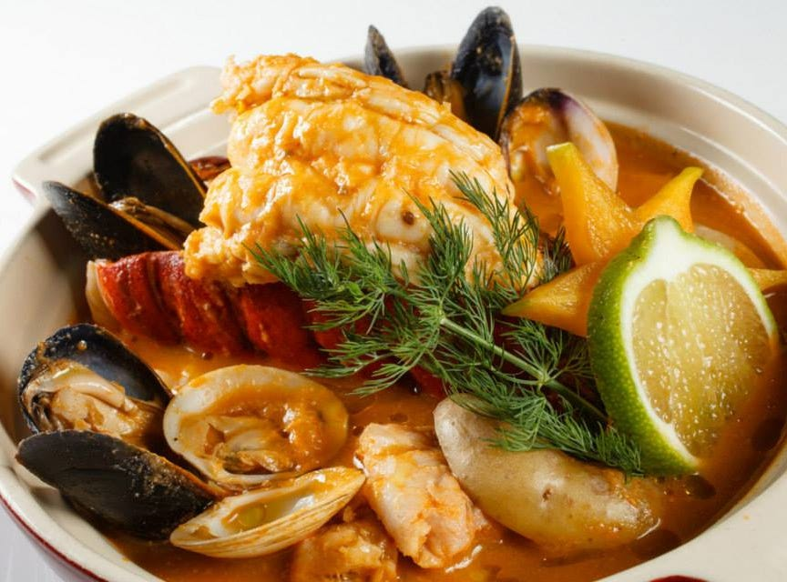 Chez Boet's bouillabaisse is made with Maine lobster tail delicately poached in a scratch-made broth of lobster, fennel root, leek, tomato and saffron.