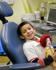 Ronald McDonald Care Mobile patient showing off healthy, happy smile.