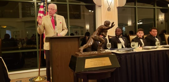 Former Heisman Trophy winner and Army general Pete Dawkins gives a speech during the National Football Foundation Collier County chapter's annual banquet on Monday, Feb. 25, 2019. Dawkins, a part-time Naples resident, received the Distinguished American Award from the chapter.