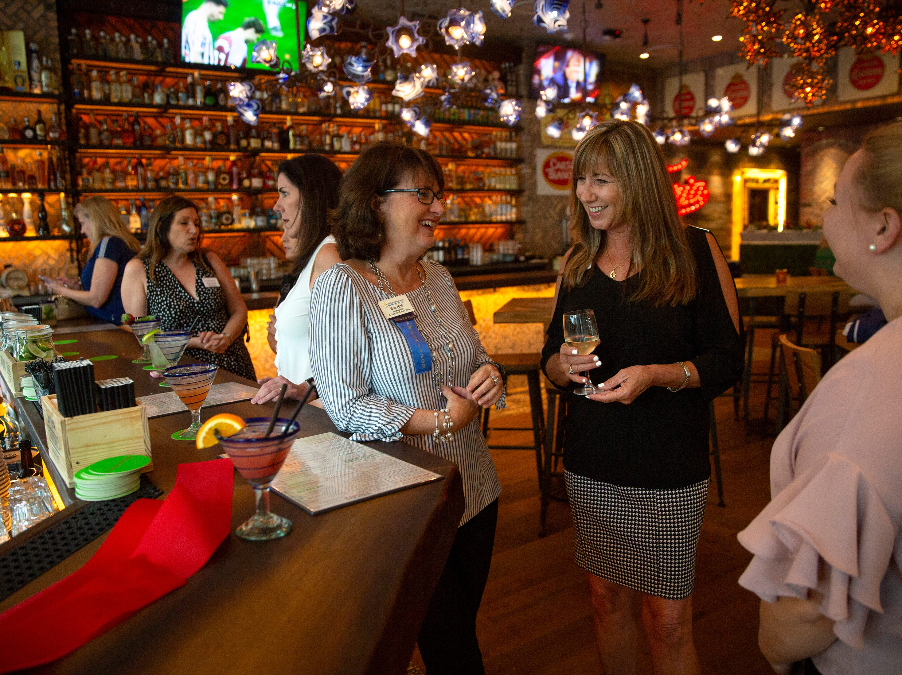 Sue Huff, center, Lisa Winters and Emily Sumpmann, right, enjoy a conversation at a preview of Rocco's Tacos & Tequila Bar on Tuesday, Feb. 26, 2019, at Mercato in North Naples. The long-waited restaurant officially opens on Wednesday.