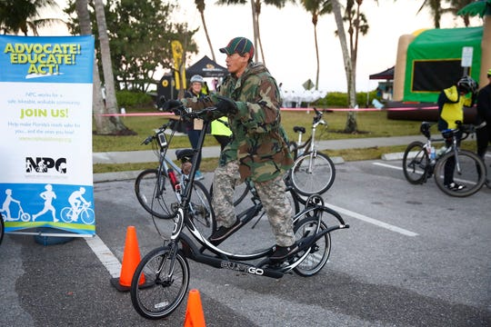 Hung Ly of CJ & Hung's House of Trikes & Bikes in Naples shows off an Elliptigo  Jan. 24, 2016, at Lowdermilk Park in Naples during the 10th Annual Naples Bike Brunch & Family Festival, put on by the Naples Pathways Coalition.