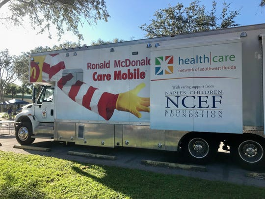 Ronald McDonald Care Mobile set up and providing dental screenings at community event.