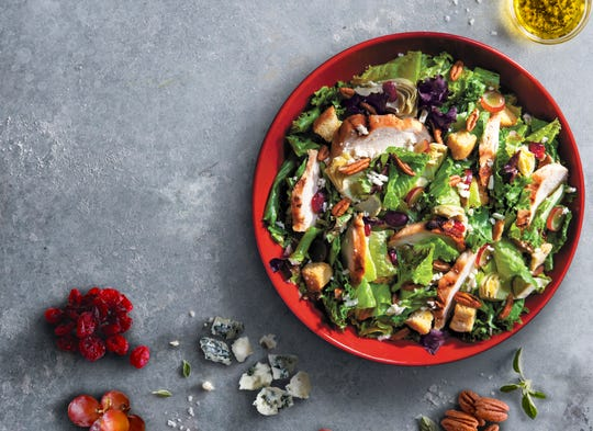 Newk's Favorite salad features grilled chicken breast, mixed greens, gorgonzola cheese, grapes, artichoke hearts, pecans, dried cranberries and house-made croutons.