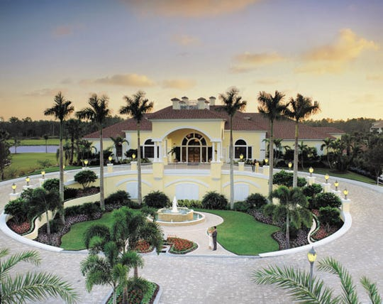 Front view of the 24,000 square foot clubhouse at Naples Lakes.