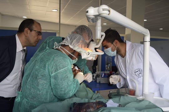 Photo courtesy of Souheil Saba- Medical students perform a procedure at the Al-Awash Private University Hospital in Homs, Syria. Souheil Saba, a retired doctor from Wayne, closed his practice last year to open a medical school and hospital in his home country of Syria.