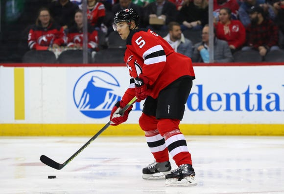 New Jersey Devils defenseman Connor Carrick (5) skates with the puck during the first period of their game against the Montreal Canadiens at Prudential Center.