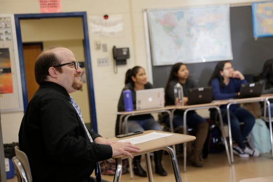 Stuart Wexler, left, leads his Advanced Placement government class in a discussion at Hightstown High School in Hightstown, N.J., Tuesday, Feb. 19.