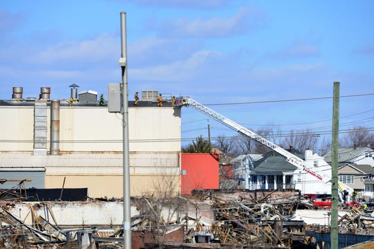 Firefighters arrived at Soundview Paper Company, which owns Marcal, in Elmwood Park on Tuesday February 26, 2019. Debris from the multiple alarm fire at the Marcal plant last month can be seen in the foreground as firefighter walk on the roof of the building.