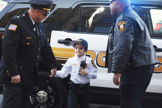 Delaney Kurdyla (age 8) of Wood-Ridge, cancer survivor and St. Joseph's Children's Hospital patient, arrives at Paterson Police Headquarters to experiences life as the Chief of Police for Paterson, photographed  on 02/26/19.
