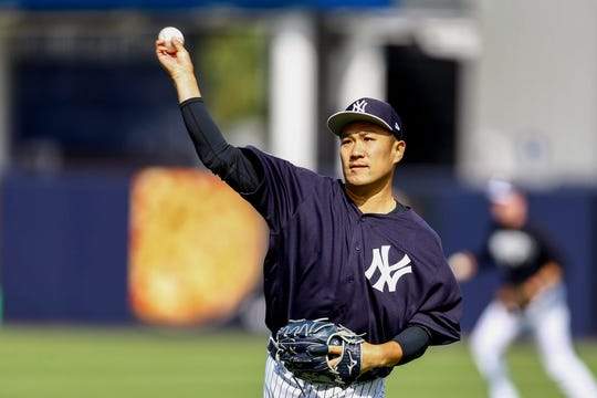 New York Yankees starting pitcher Masahiro Tanaka (19) throws during spring training at George M. Steinbrenner Field.