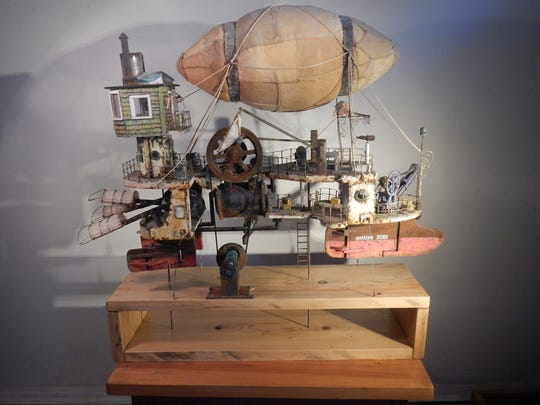 "The Morris Museum 's exhibit, called ""A Cache of Kinetic Art: Simply Steampunk"" includes The Flying Machine, created by  Ken Draim in 2015"