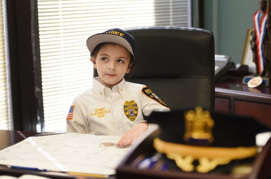 Delaney Kurdyla (age 8) of Wood-Ridge, cancer survivor and St. Joseph's Children's Hospital patient, sits at the desk of Chief Troy Oswald as she experiences life as the Chief of Police for Paterson, photographed at Police Headquarters in Paterson on 02/26/19.