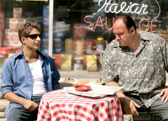 "This undated image released by HBO shows Michael Imperioli, left, and James Gandolfini in a scene from ""The Sopranos."" The TV show is celebrating the 20th anniversary of its premiere. The six-season show would win 21 Emmys and become the first cable series ever to win the Emmy for outstanding drama series. (HBO via AP)"