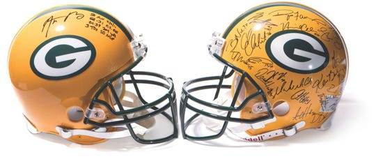 Green Bay Packers memorabilia. Brett Favre helmet from 2007 with 43 of the 53-man roster's signatures, a signed Aaron Rodgers helmet with his Super Bowl MVP stat line.